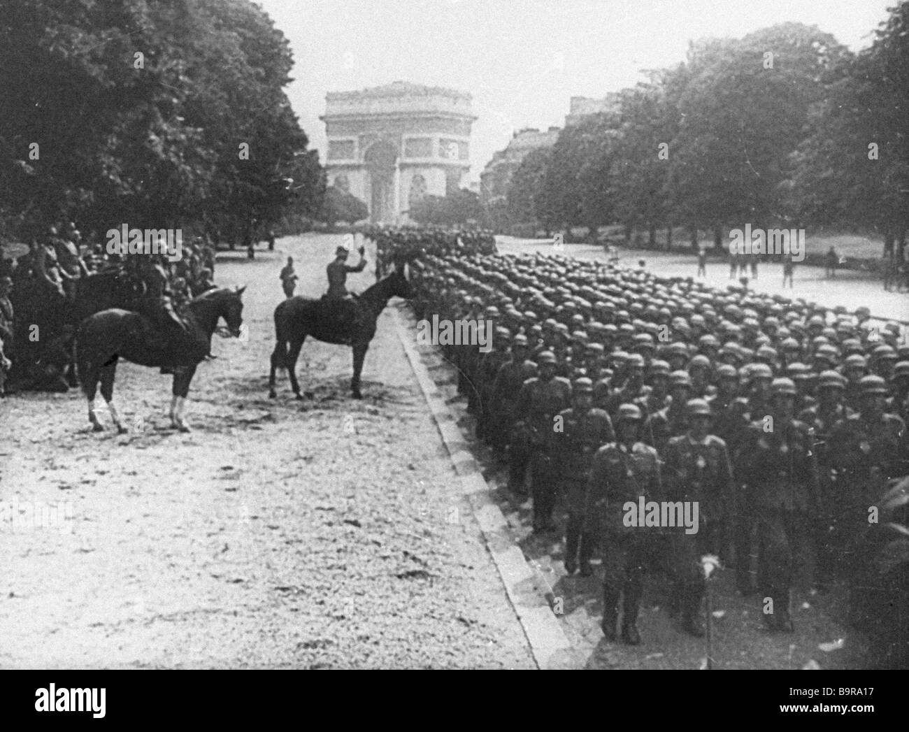 The Hitler troops in the streets of Paris in The Great Victory of the Soviet People documentary Stock Photo