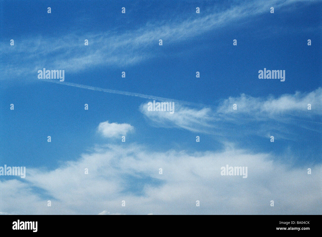 Cloudscape and vapor trail - Stock Image