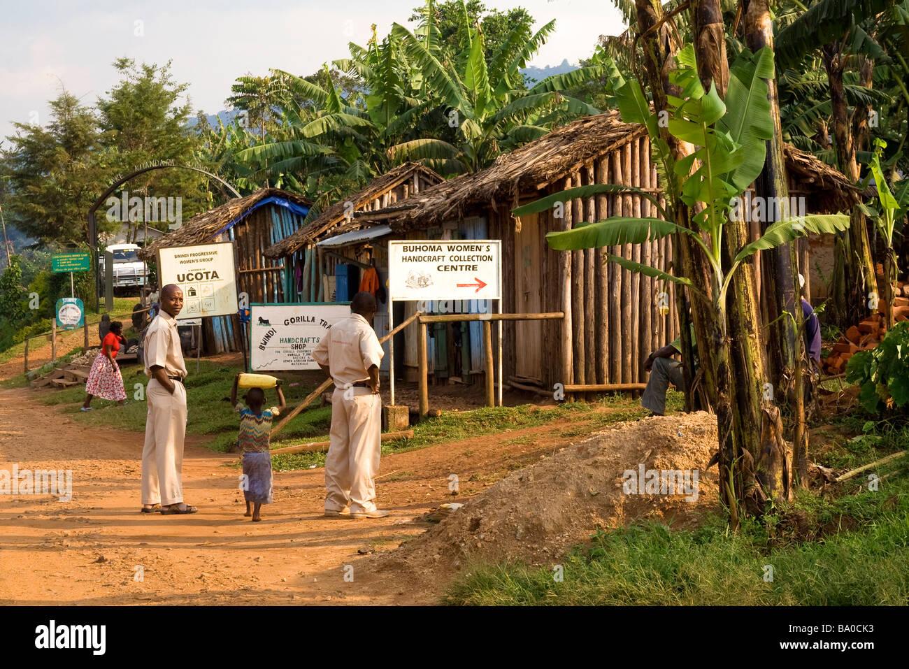 Street scene in Buhoma, Uganda. People in the street, wooden houses, banana trees. East Africa Stock Photo