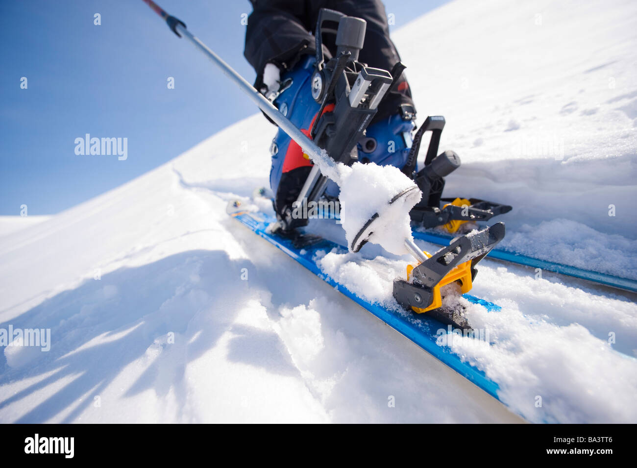 Close up of a backcountry ski and boot in motion on a trek in Alaska during Winter - Stock Image
