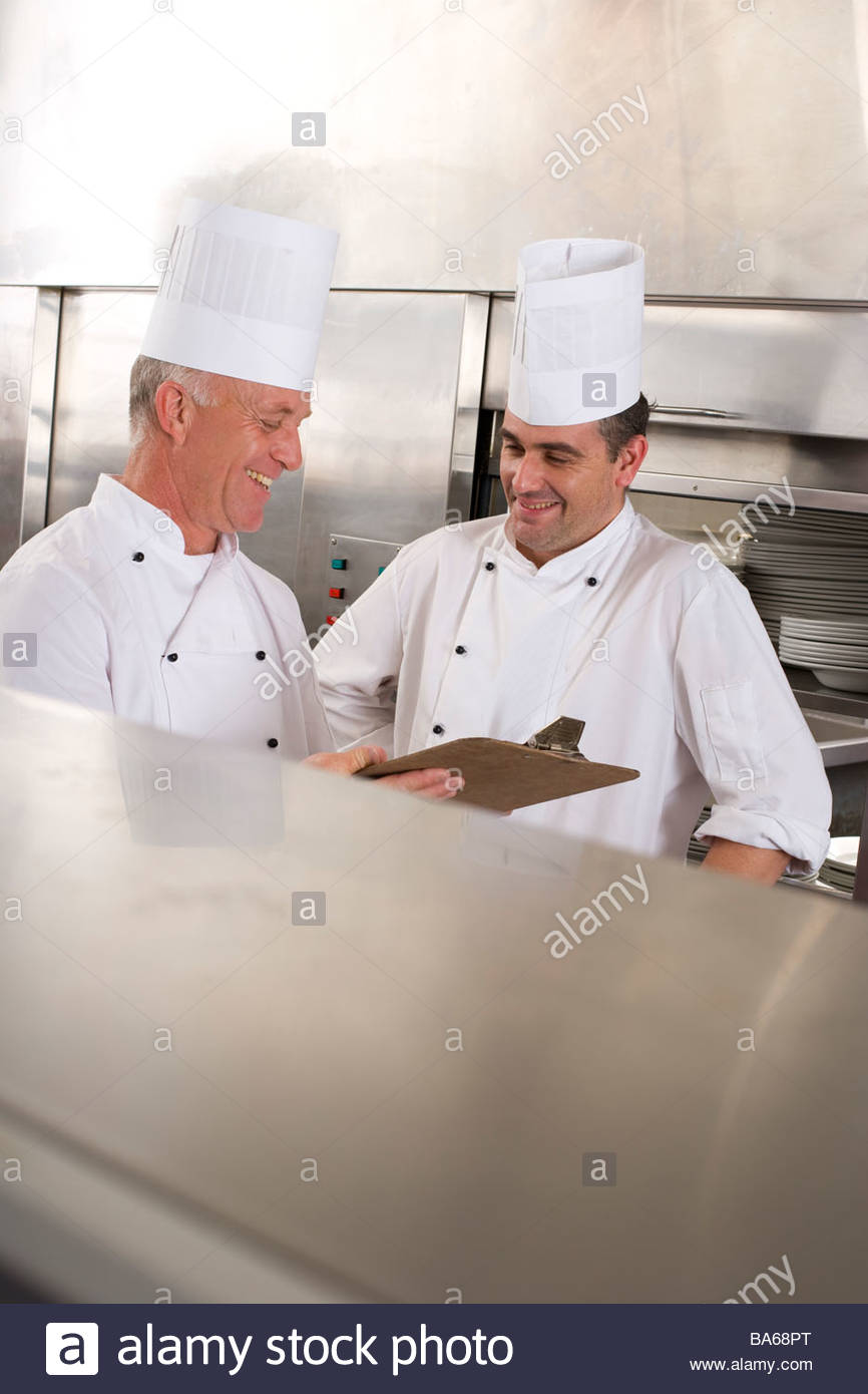 Chefs in commercial kitchen - Stock Image
