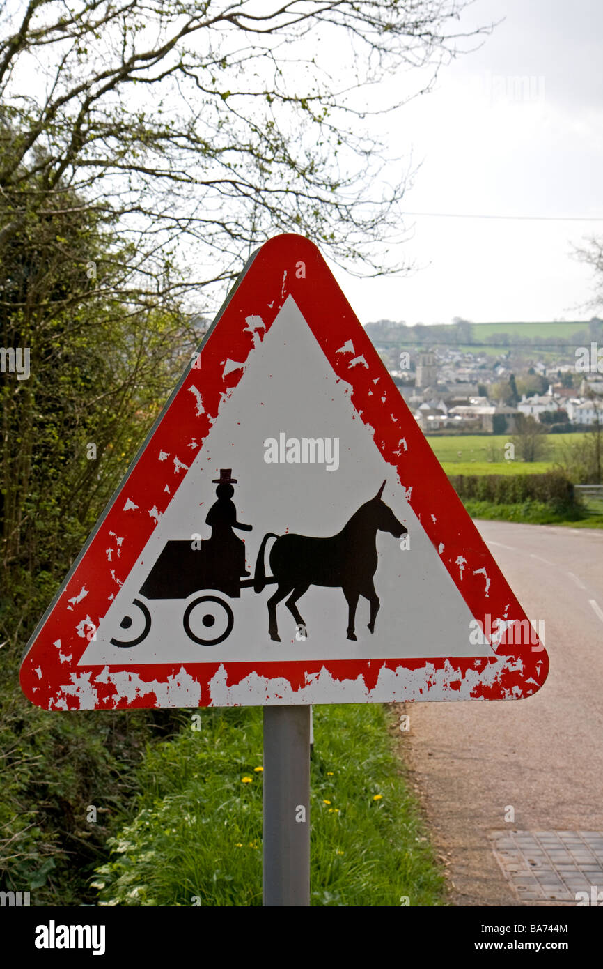 horse-and-cart-road-warning-sign-thats-been-doctored-colyton-devon-BA744M.jpg