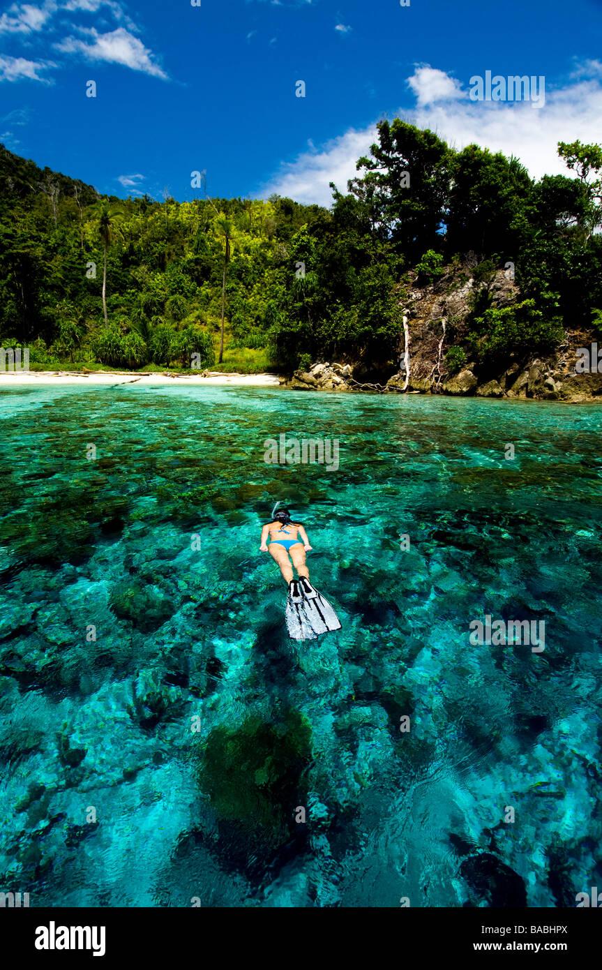Snorkeling in Raja Empat, Papua, Indonesia, female diver, bikini, clear water, shallow water,  fotosub, great visibility - Stock Image