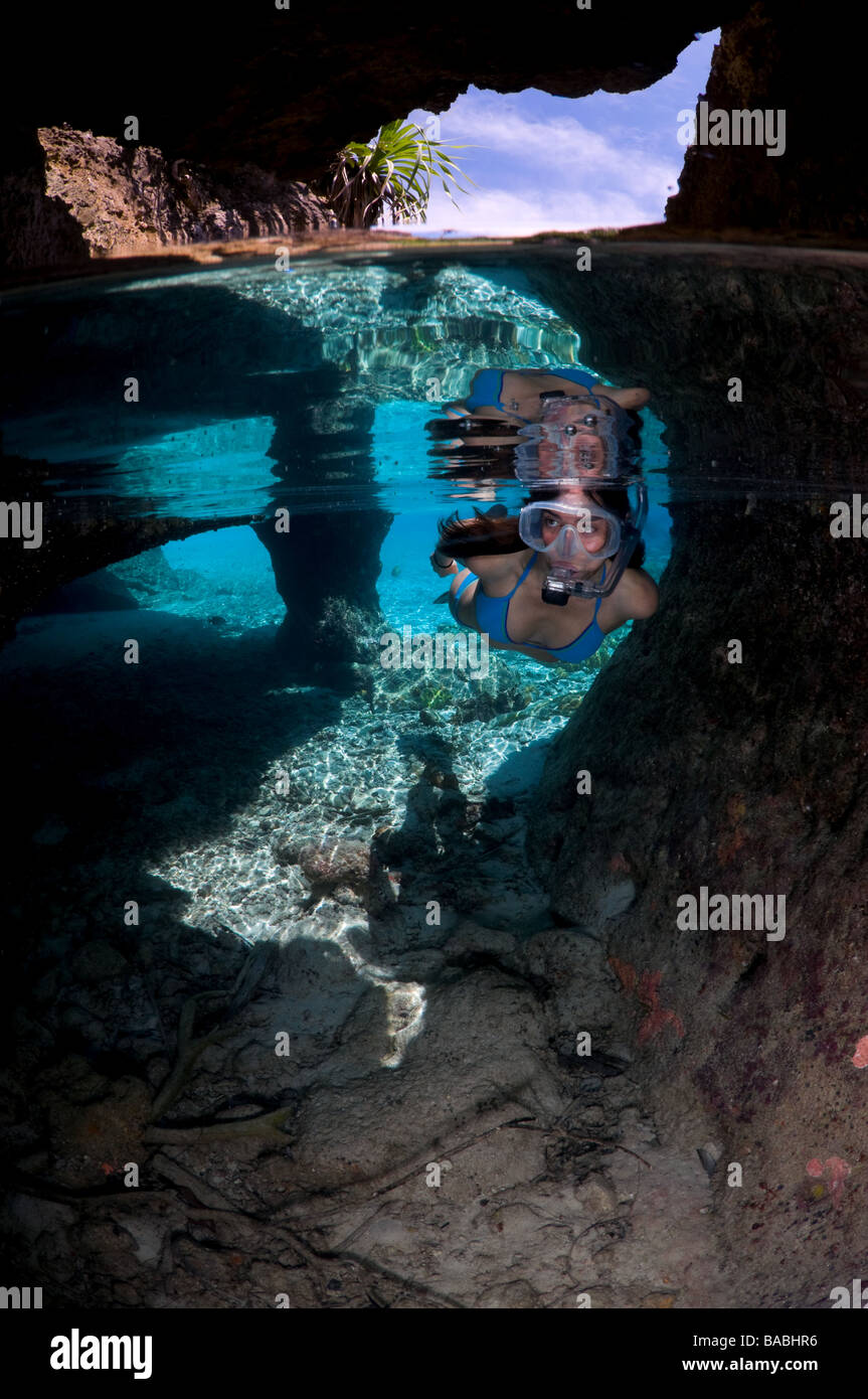Snorkeling in Raja Empat, Papua, Indonesia, female diver, bikini, clear water, shallow water, split, fotosub, great - Stock Image