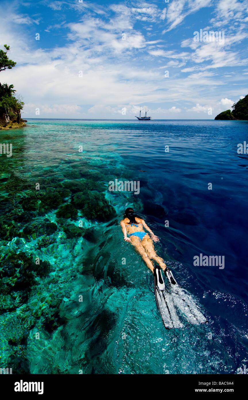 Snorkeling in Raja Empat, Papua, Indonesia, female diver, bikini, clear water, shallow water,  fotosub, great visibility, - Stock Image