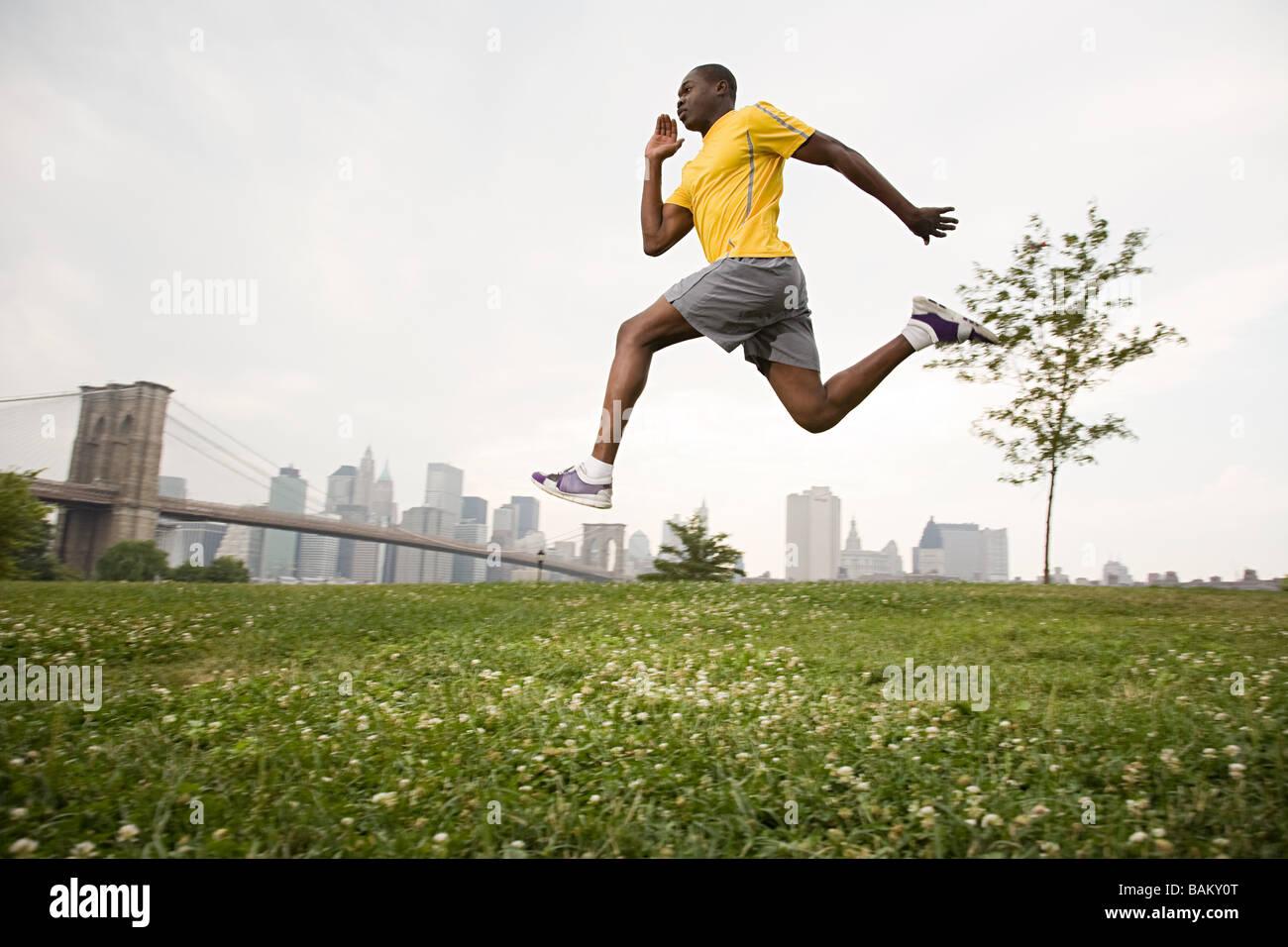 Athlete jumping - Stock Image