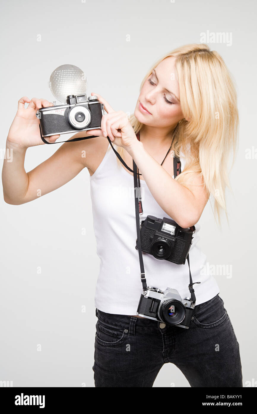 A young woman taking pictures - Stock Image