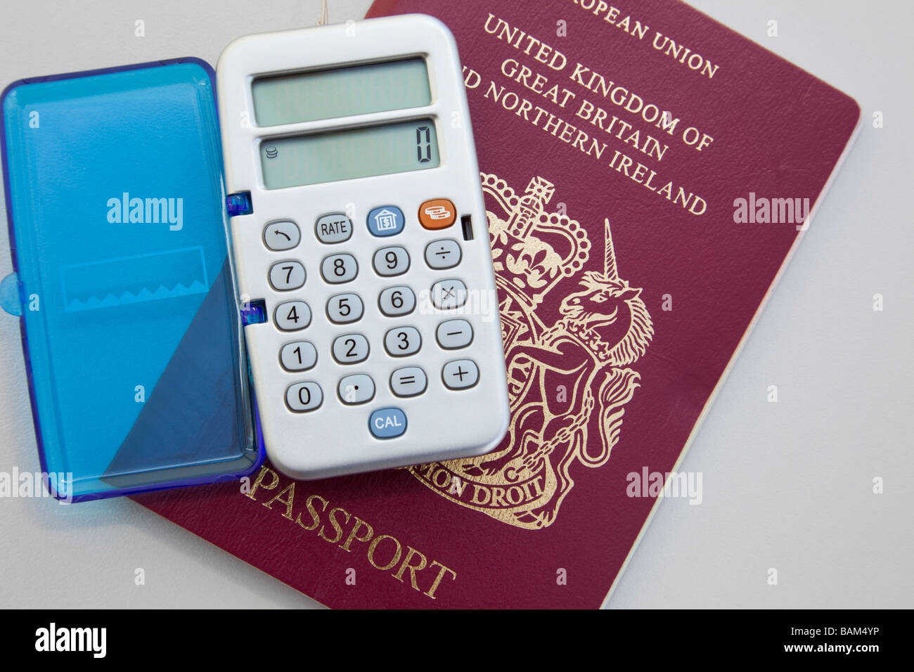 british passport and currency converter calculator stock photo