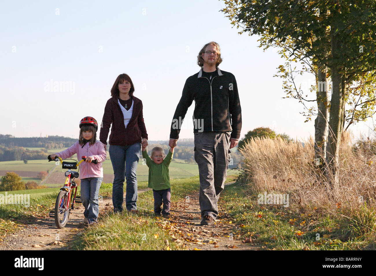 Young family taking a walk - Stock Image