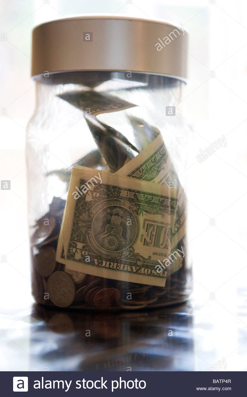 Close up of money in jar - Stock Image