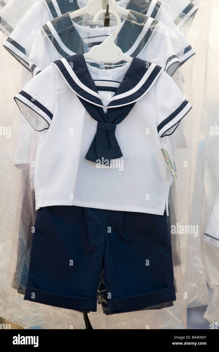 Children's Sailor suit for sale on a local Spanish market in Murcia Spain - Stock Image