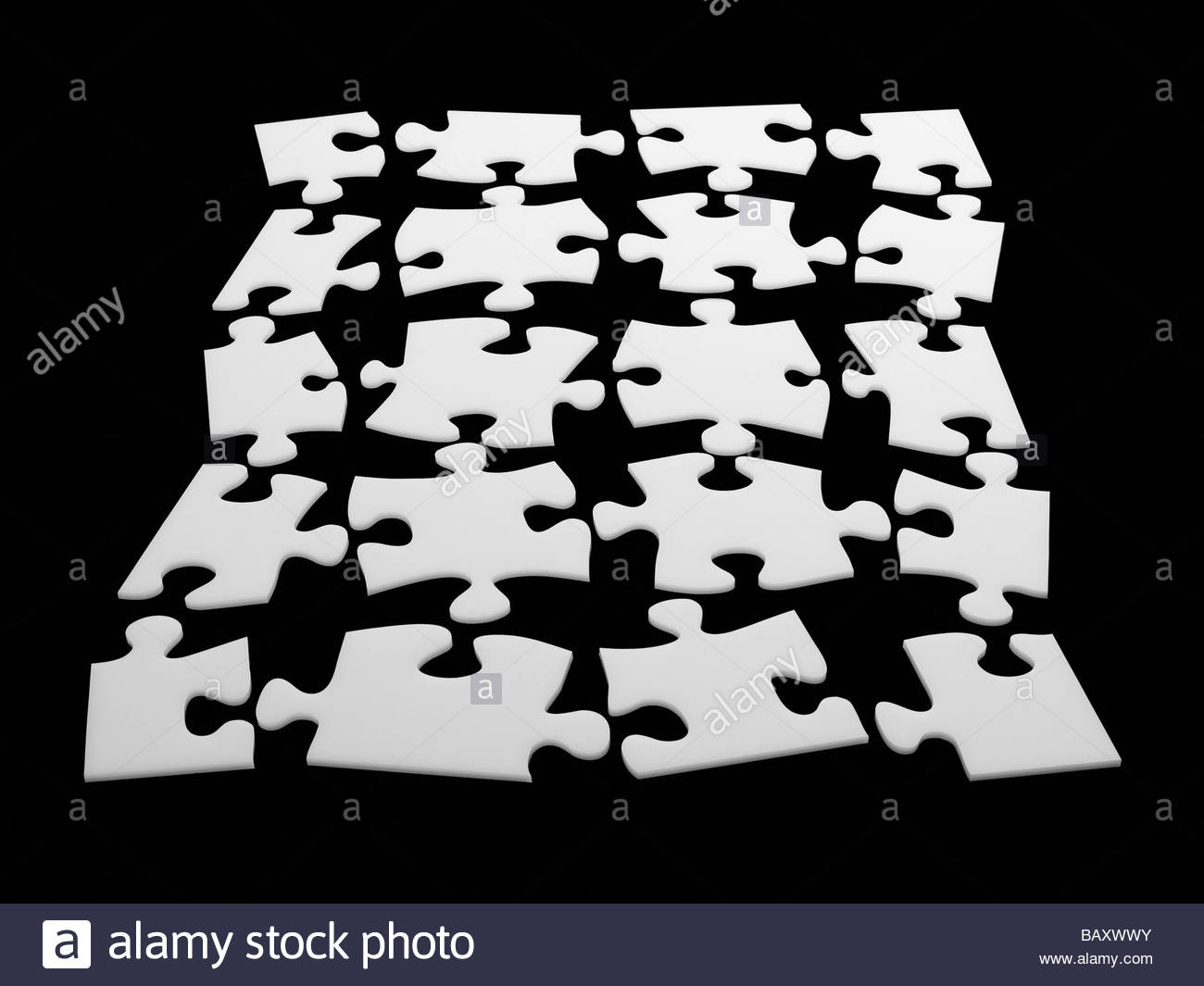 Individual puzzle pieces in puzzle shape - Stock Image
