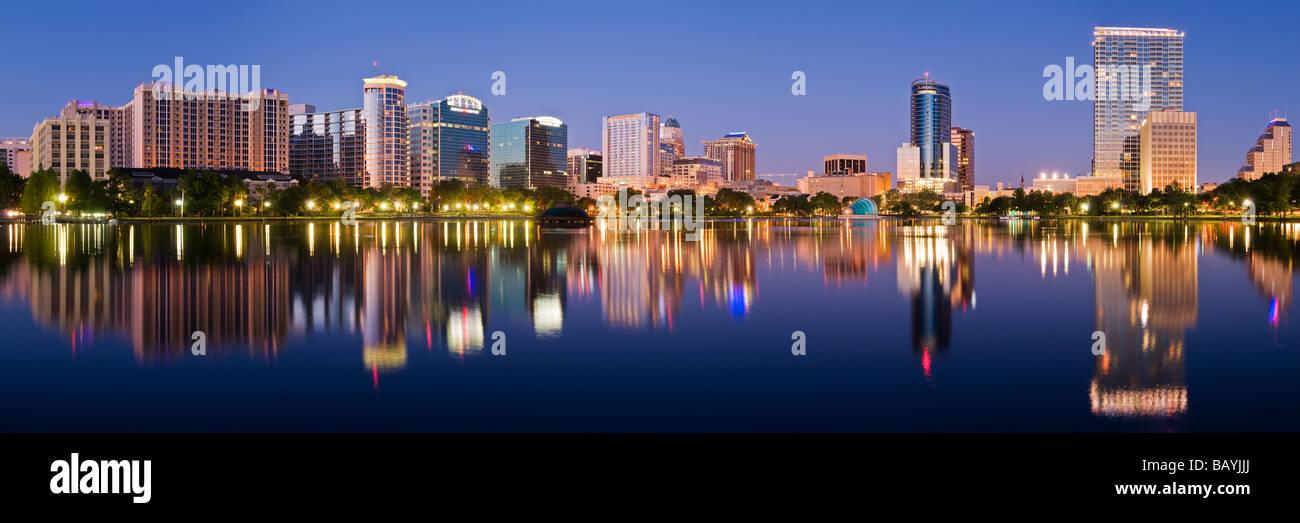 Downtown Orlando Florida skyline reflected in Lake Eola - Stock Image