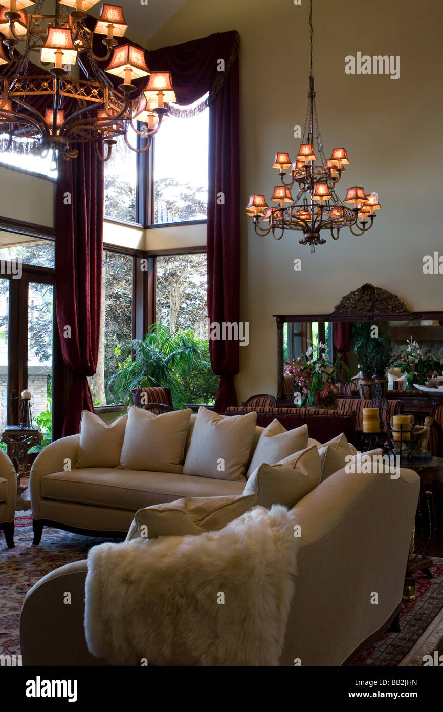 High Ceiling Living Room With Chandeliers And Wall To Ceiling