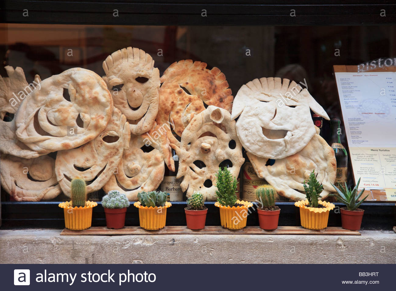pizza-base-faces-in-a-restaurant-window-BB3HRT.jpg