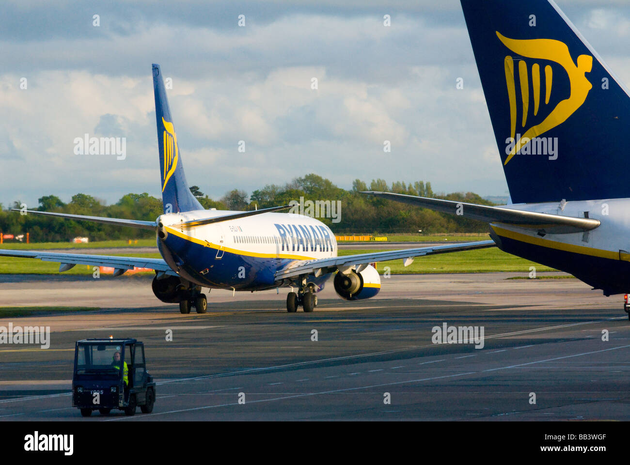image of budget airline aircraft taxiing on runway - Stock Image