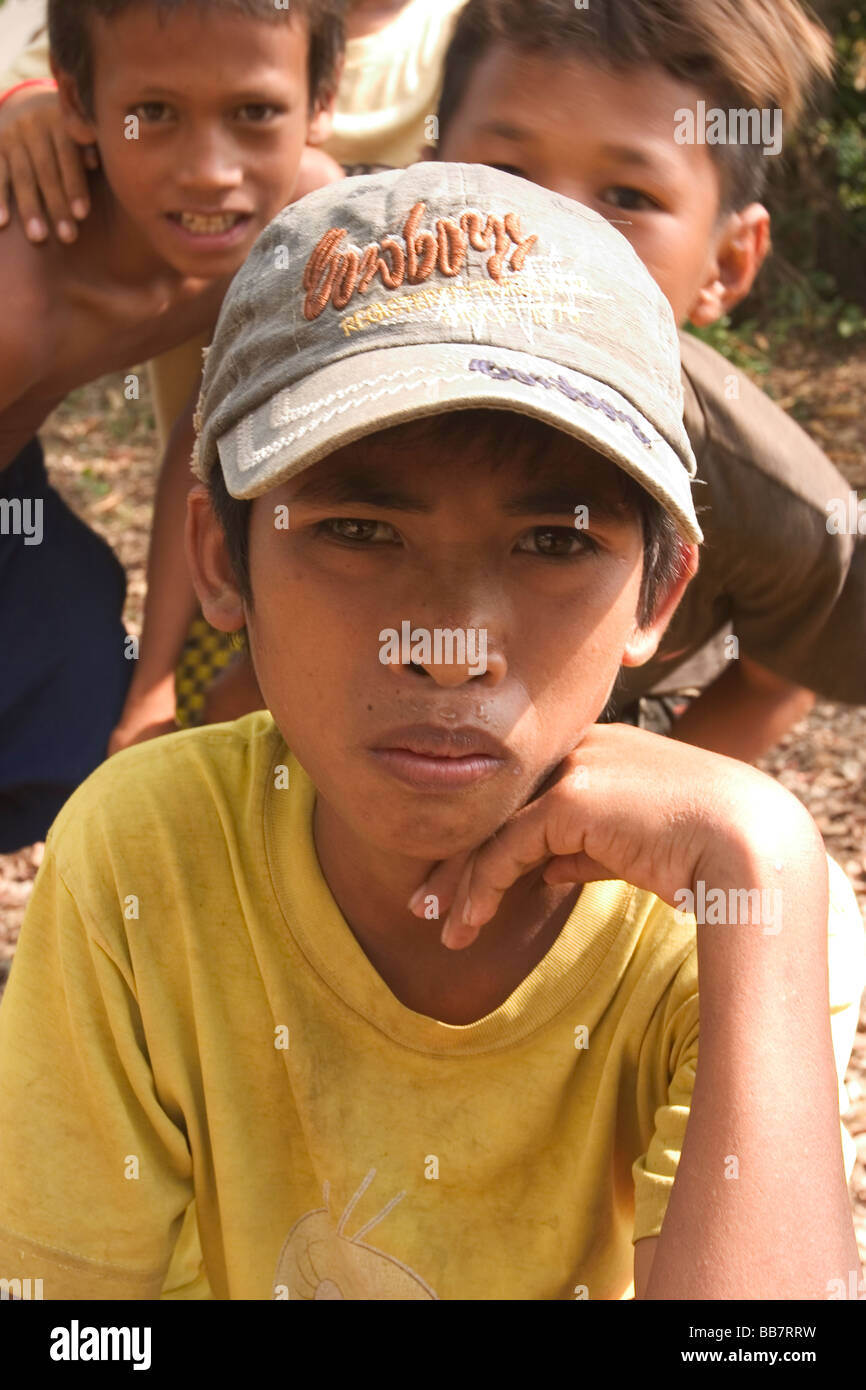 Local children roam the area around the Killing Fields of Choeung Ek, roughly 17 km from Phnom Penh, Kingdom of - Stock Image