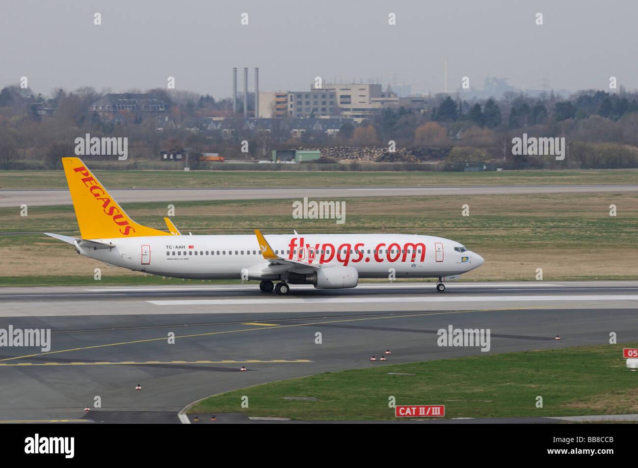 Pegasus Boeing 737-800 on the runway, flypgs.com, Turkish airline, Duesseldorf International Airport, North Rhine - Stock Image