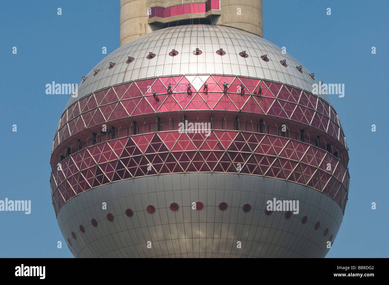 Window washers clean the outside of the Oriental Pearl Tower in Shanghai China - Stock Image