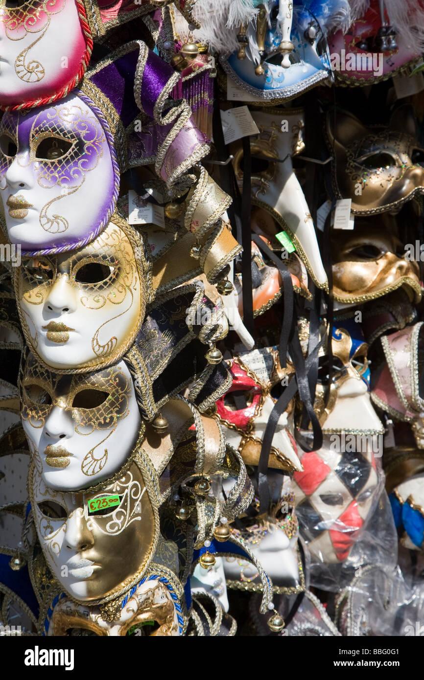 Venetian masks on a stall - Stock Image