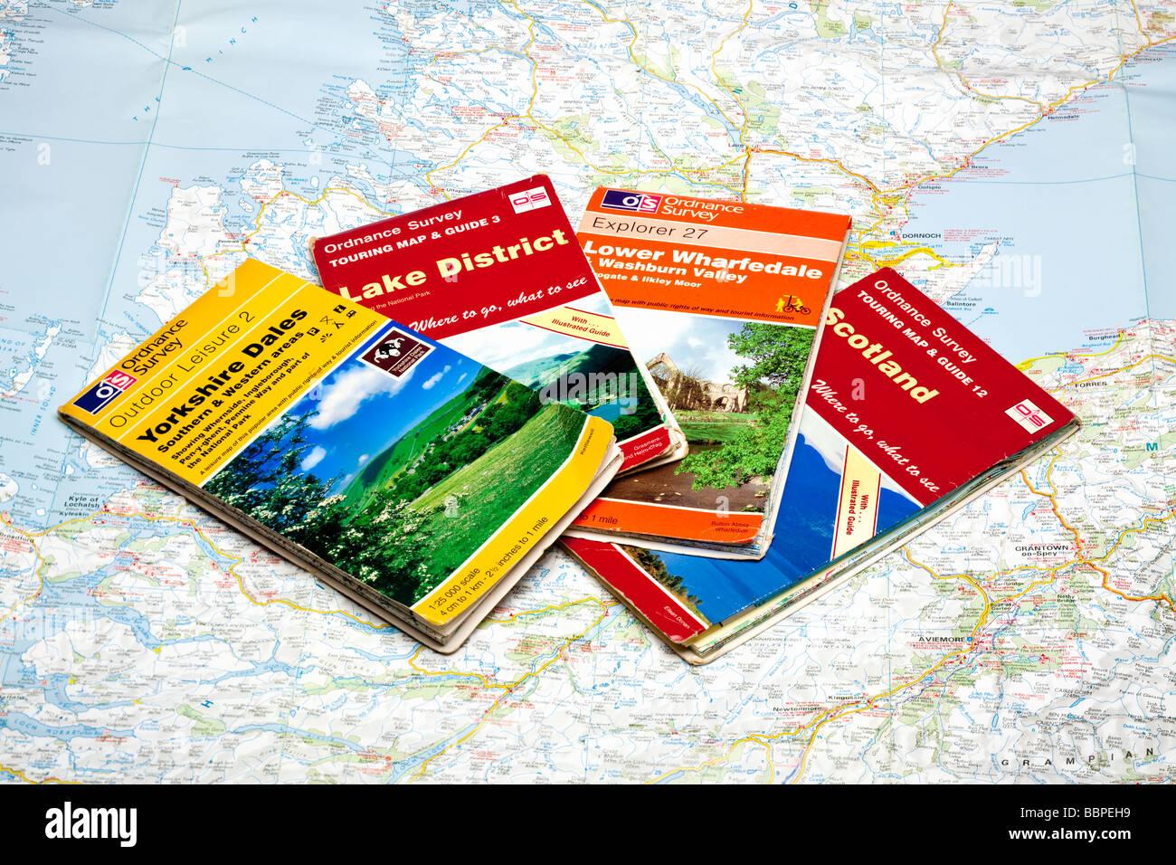 Set of four Ordnance Surveys maps on a map of Scotland - Stock Image