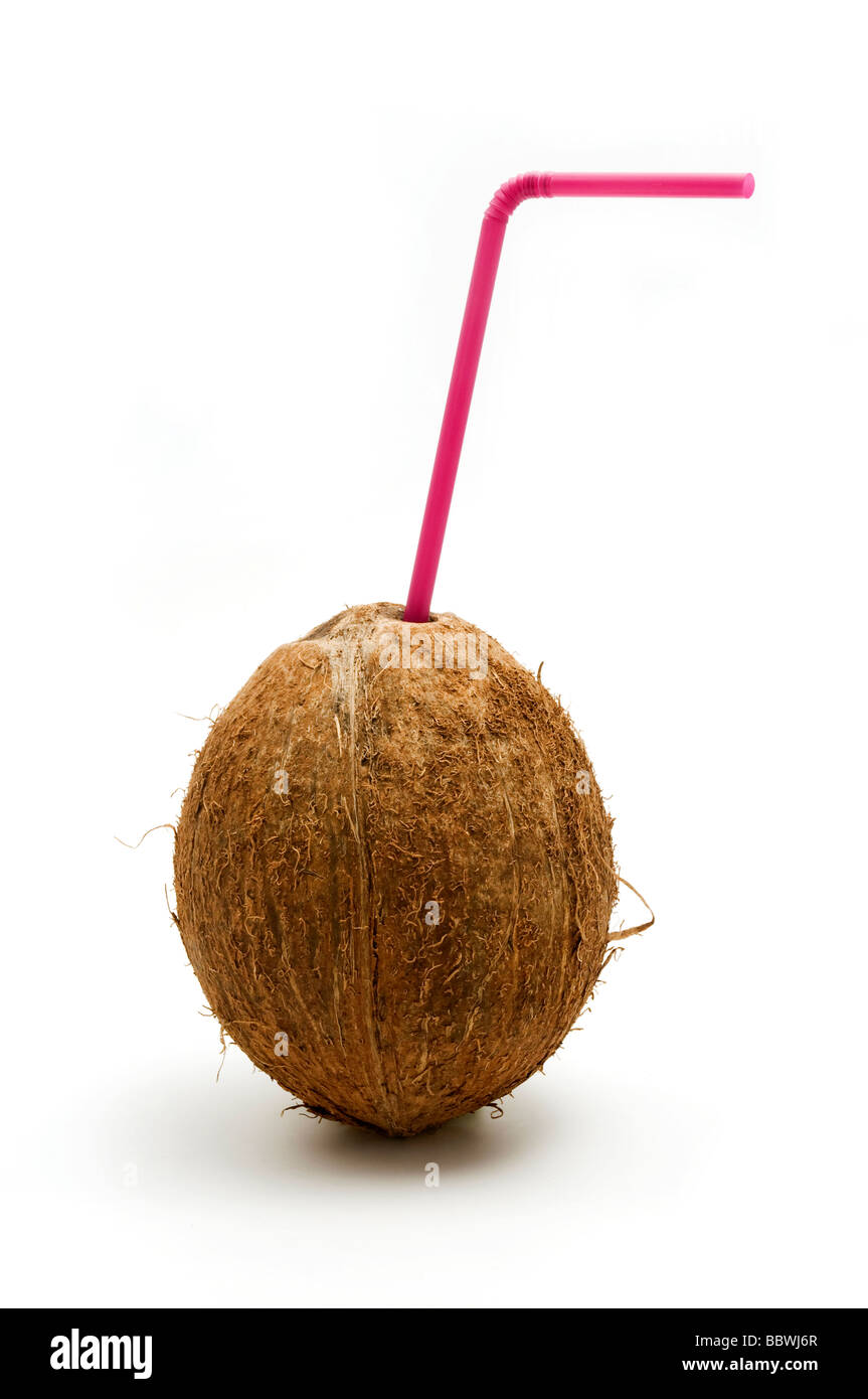 Coconut with a purple straw on a white background - Stock Image