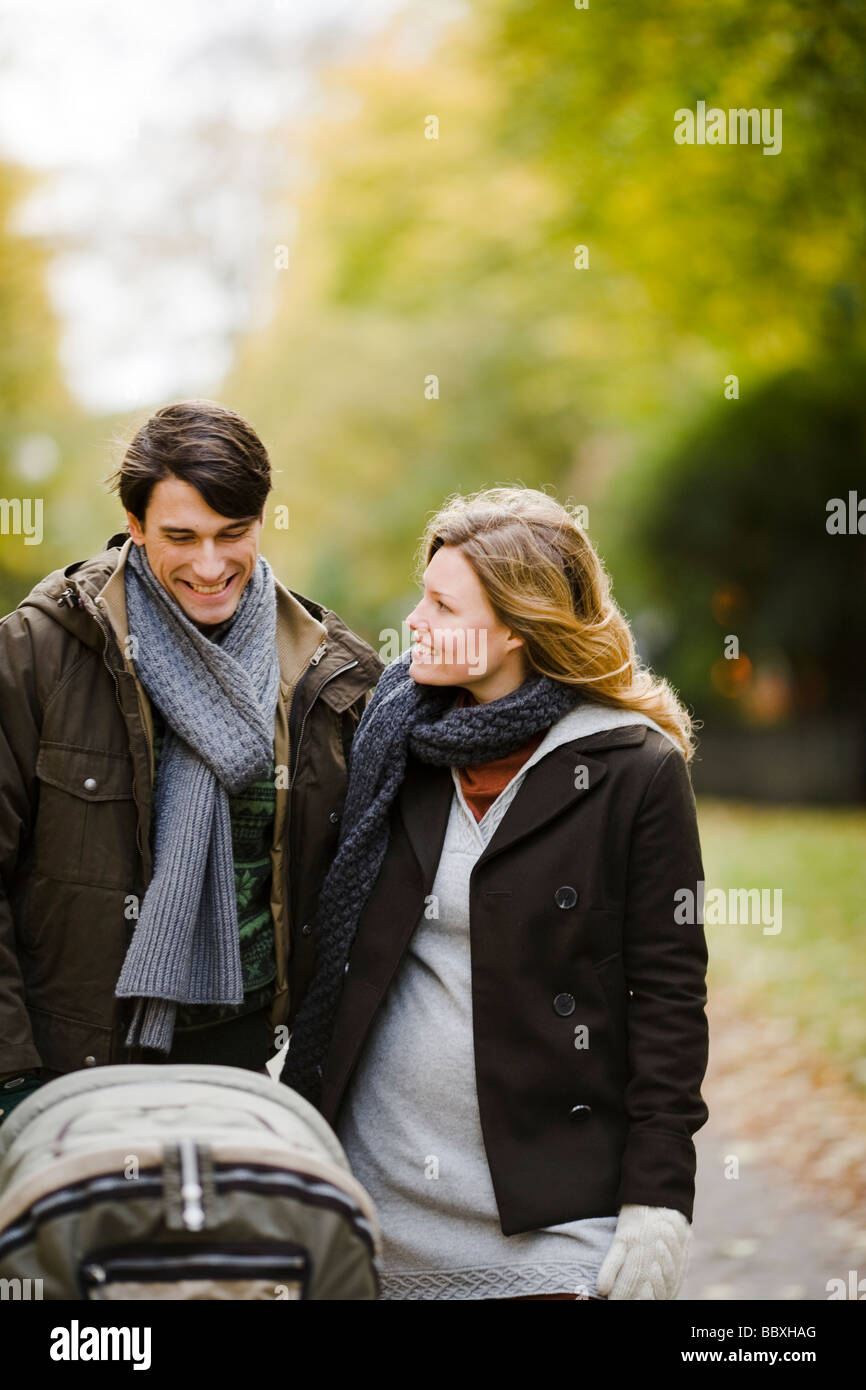 A couple taking a walk with their baby Sweden. Stock Photo
