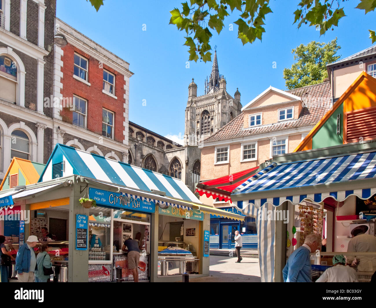 Corner of Norwich Market showing St Peter Mancroft Medieval Church, market stalls & Old buildings Stock Photo
