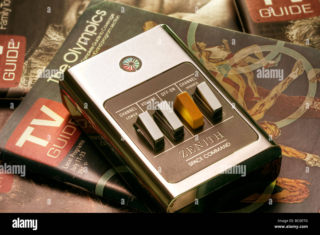Zenith Space Command clicker remote placed on period-specific 1970's TV-guide magazines Stock Photo
