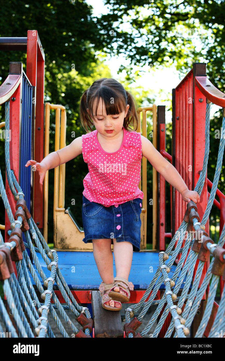 Two 2 Year Old Young Girl Child Pre School Toddler Crosses A Rope