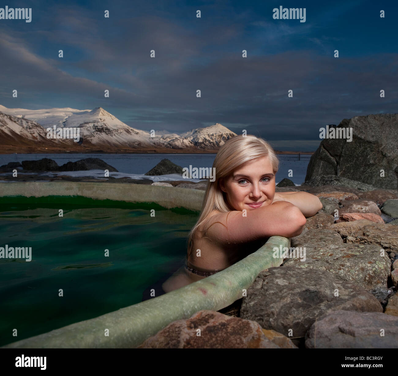 Young Woman in Geothermal Heated Hot Tub, Hornafjordur, Eastern Iceland - Stock Image