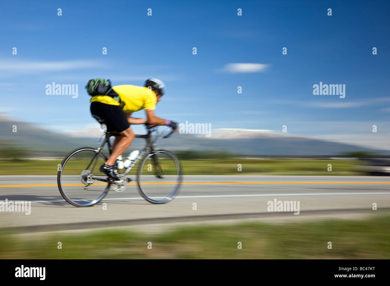 Cyclists riding between Salida and Buena Vista in Colorado during the annual Ride The Rockies bicycle tour - Stock Image