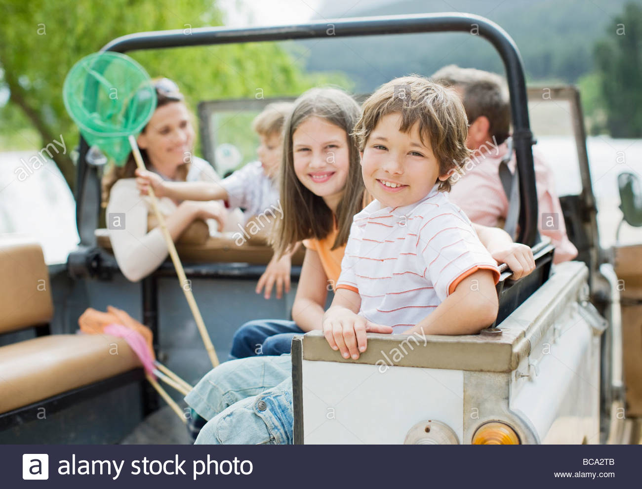 Family sitting in jeep - Stock Image