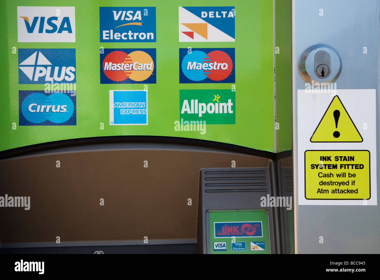 Atm with credit card signs and warning that ink system will destroy atm with credit card signs and warning that ink system will destroy money if machine is attacked barry wales uk colourmoves