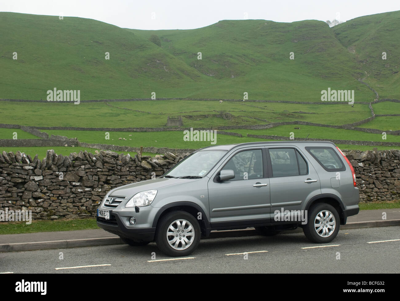Side view of a Honda CRV 4x4 car parked at the side of the road in rural Derbyshire England - Stock Image