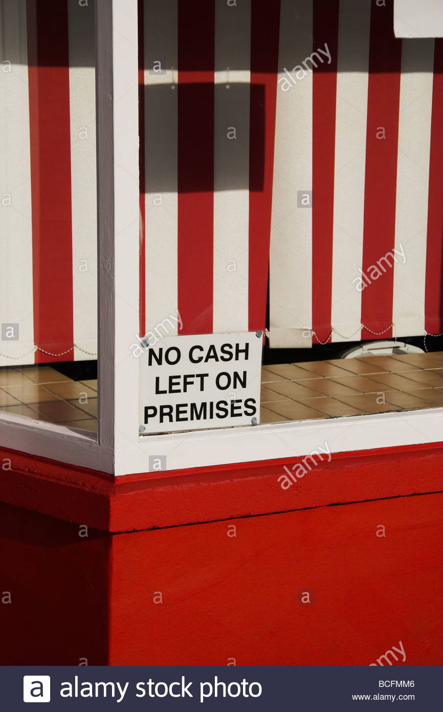 'NO CASH LEFT ON PREMISES' sign in barber's window, England, UK. Stock Photo