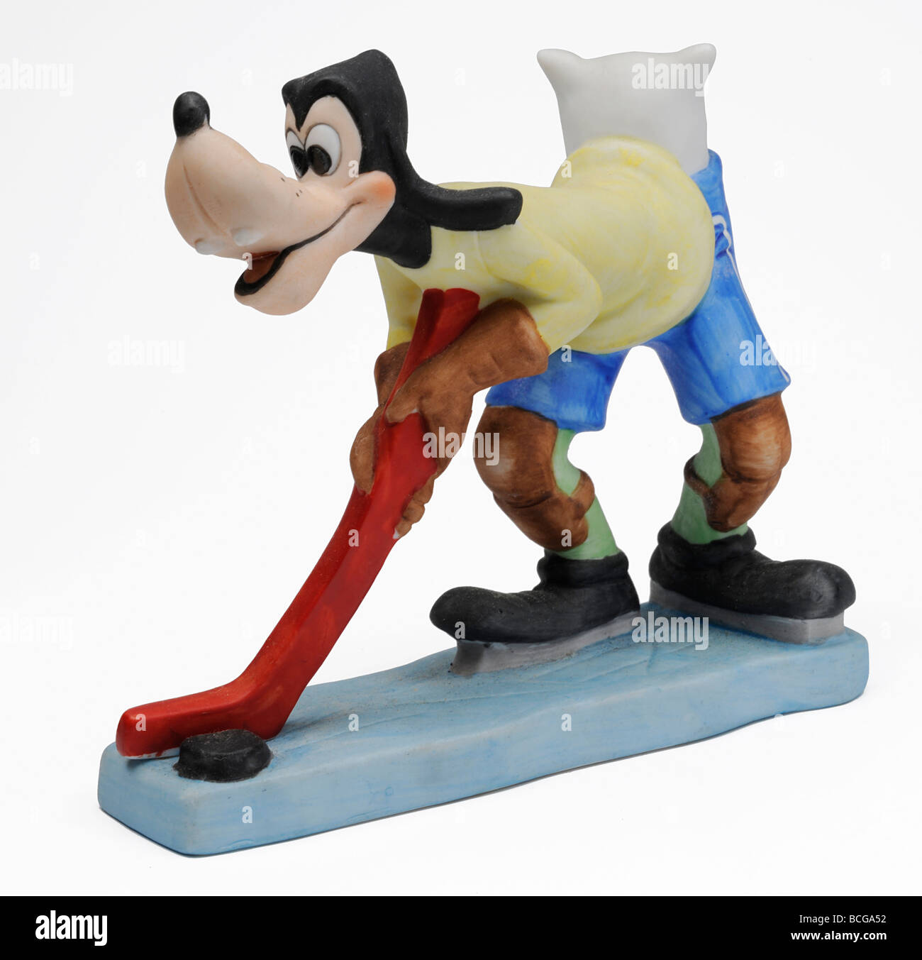 Pluto playing ice-hockey with pillow down the back of his shorts. - Stock Image