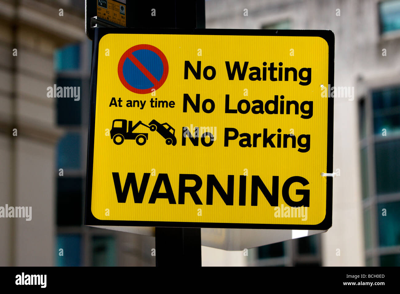 Car parking sign. No Waiting, No Loading, No Parking at any time Warning sign attached to a lampost in Brighton, Stock Photo