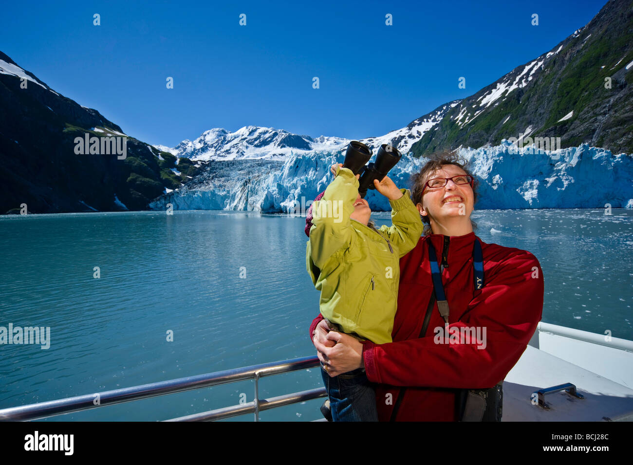 Mother and daughter enjoy a tour in Harriman Fjord aboard the Klondike Express in Southcentral Alaska - Stock Image