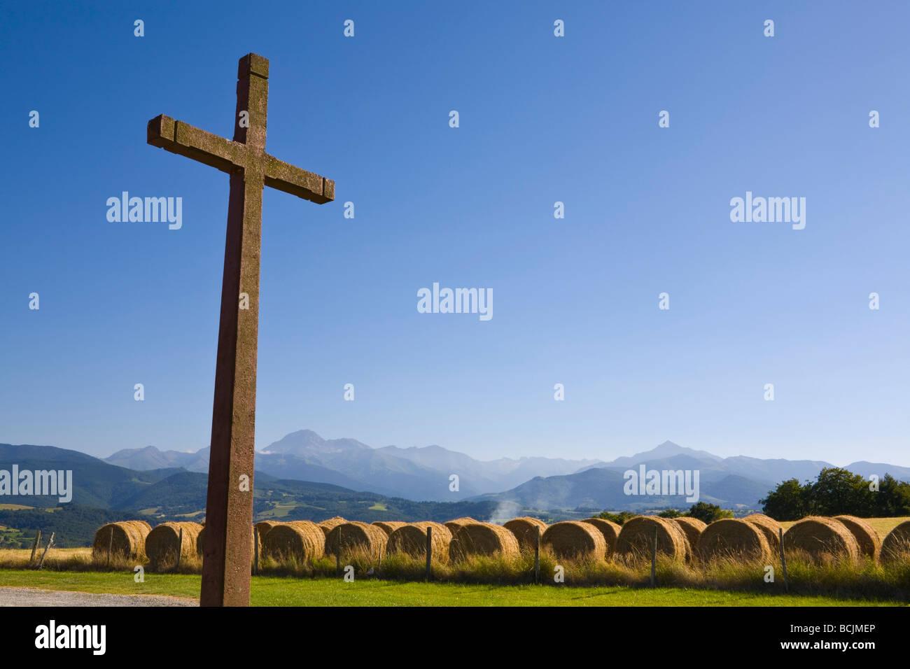 Crucifix & Hay Bales, Chapel Cieutat, Hautes-Pyrenees, France - Stock Image