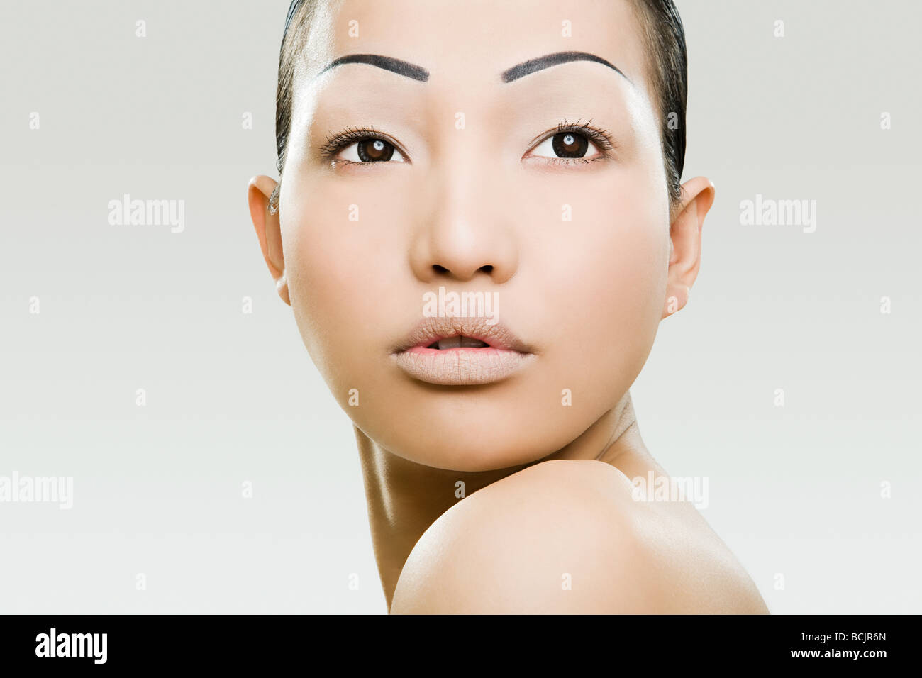 Young woman with painter eyebrows - Stock Image