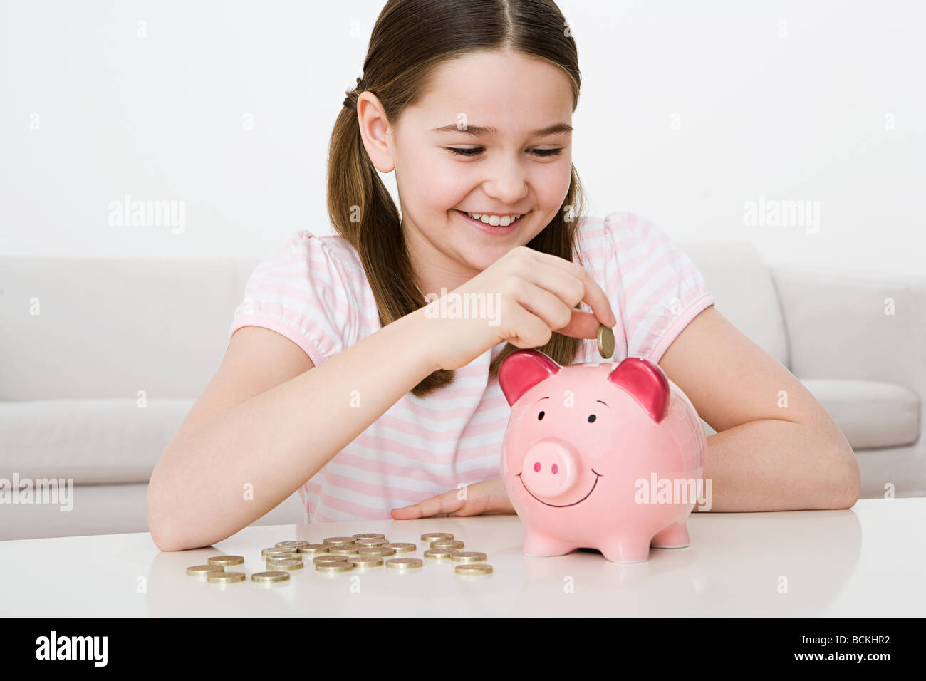 Young girl with piggy bank Stock Photo