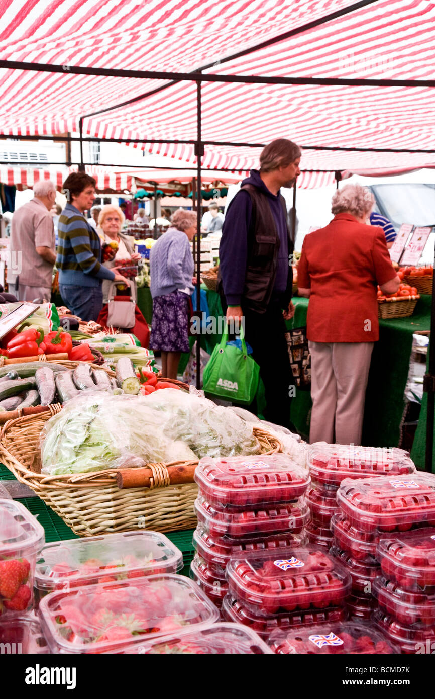 A fruit and vegetable stall at the Thursday famer's market in the typical English market town of Devizes Wiltshire - Stock Image