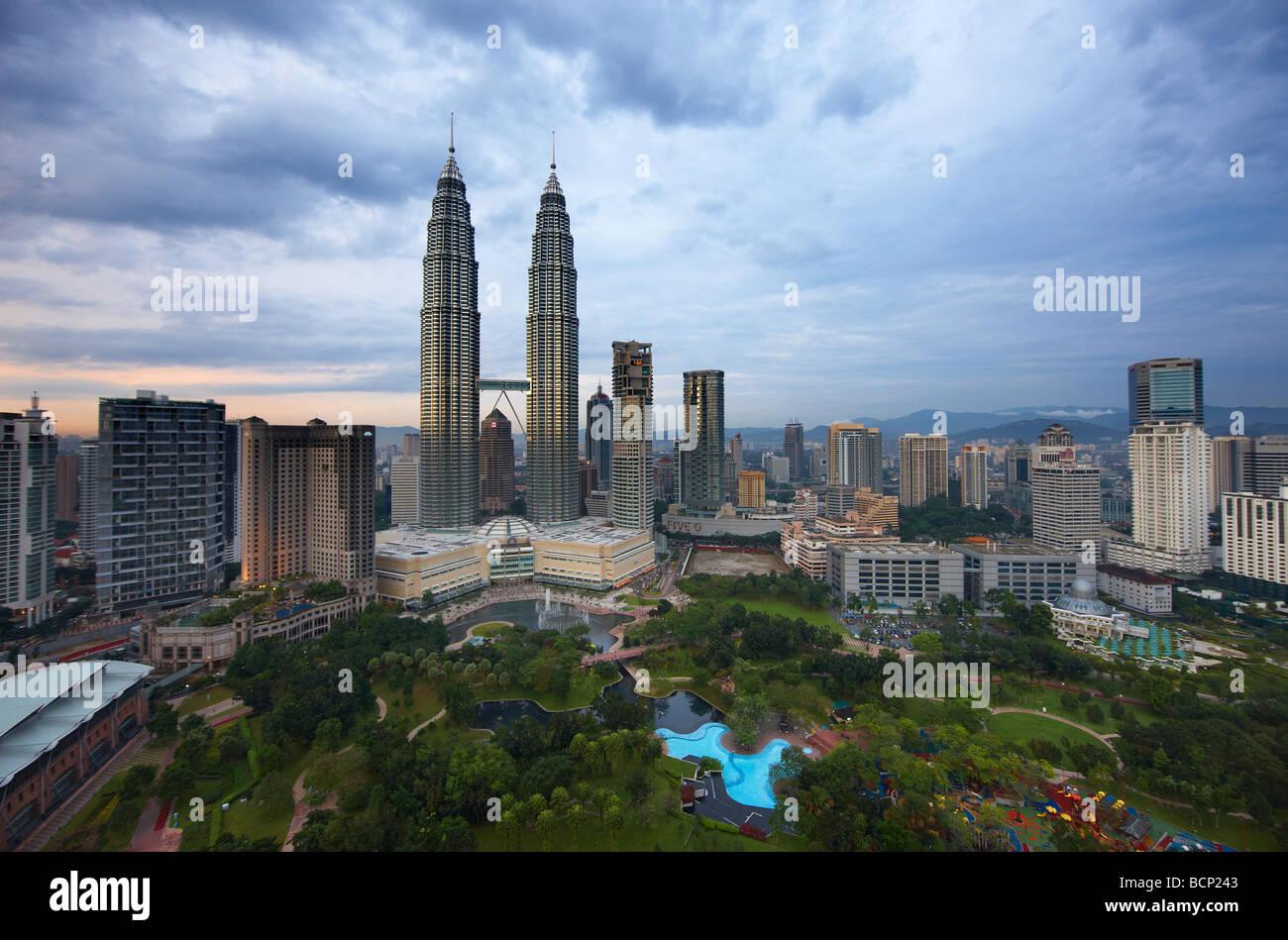 the Petronas Towers and the Kuala Lumpur skyline at dusk, Malaysia - Stock Image