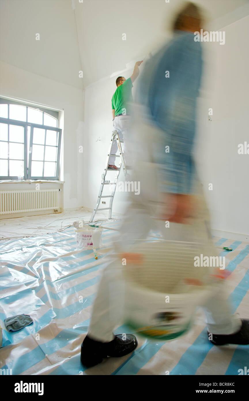house painter renovating - Stock Image