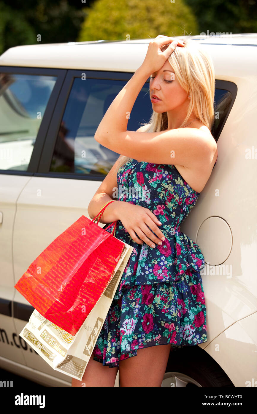 Woman tired with shopping bags - Stock Image
