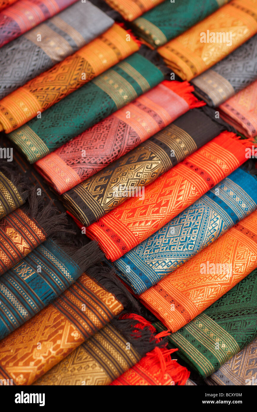 silk textiles for sale in the Night Market, Luang Prabang, Laos - Stock Image