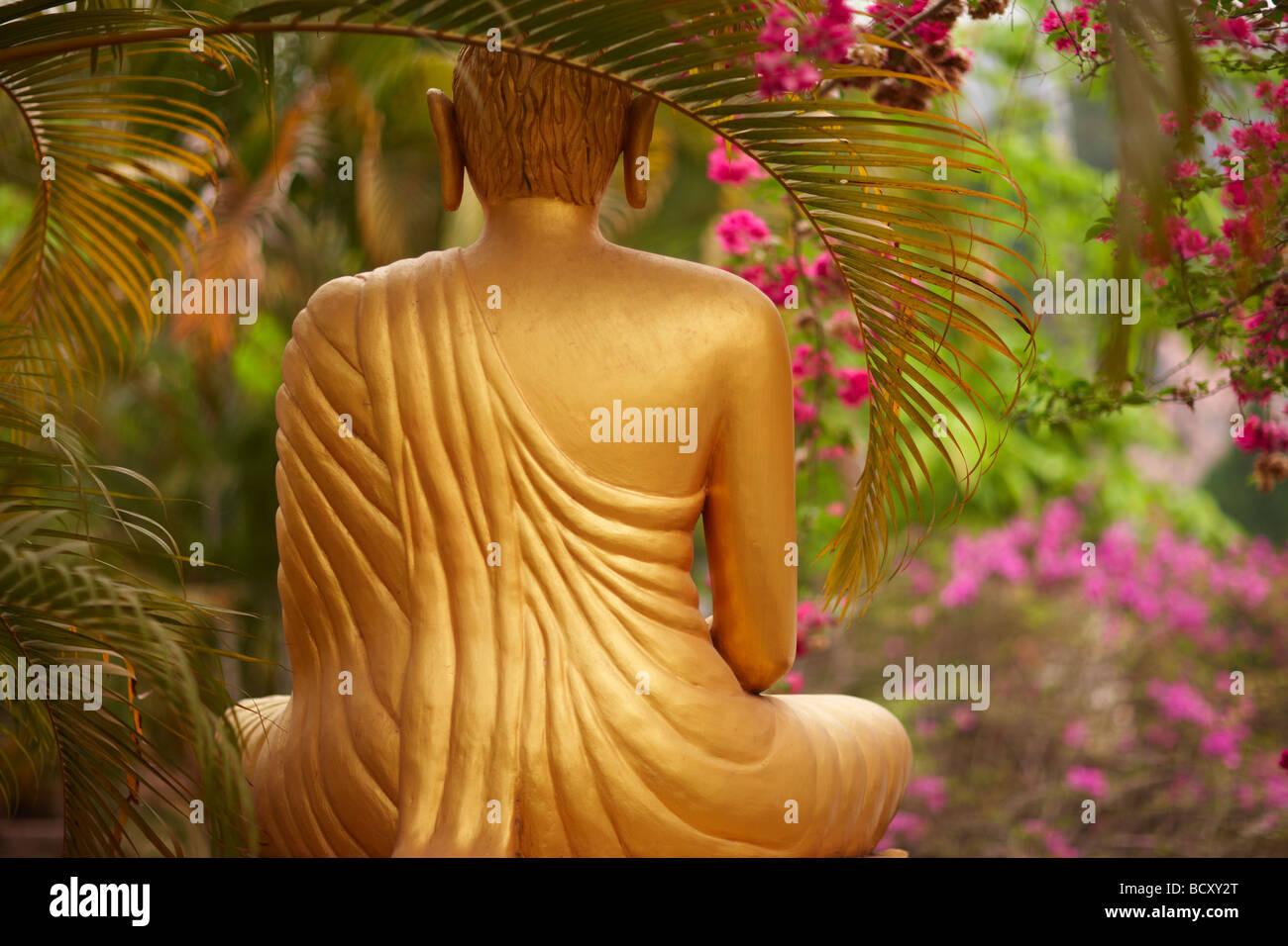 a statue of Buddha in a garden, Luang Prabang, Laos - Stock Image