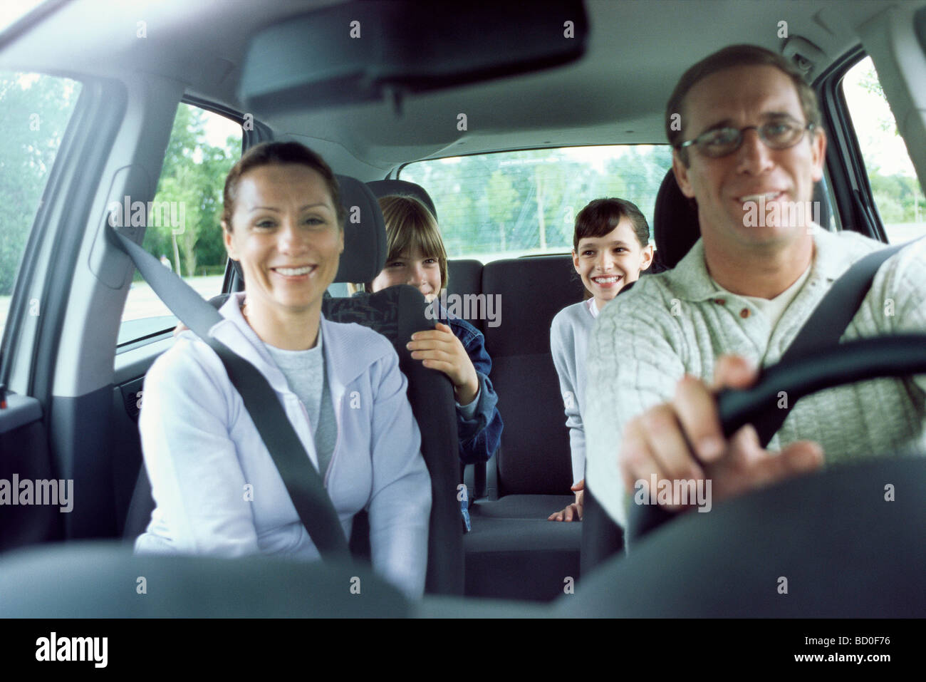 Family together in car on road trip - Stock Image