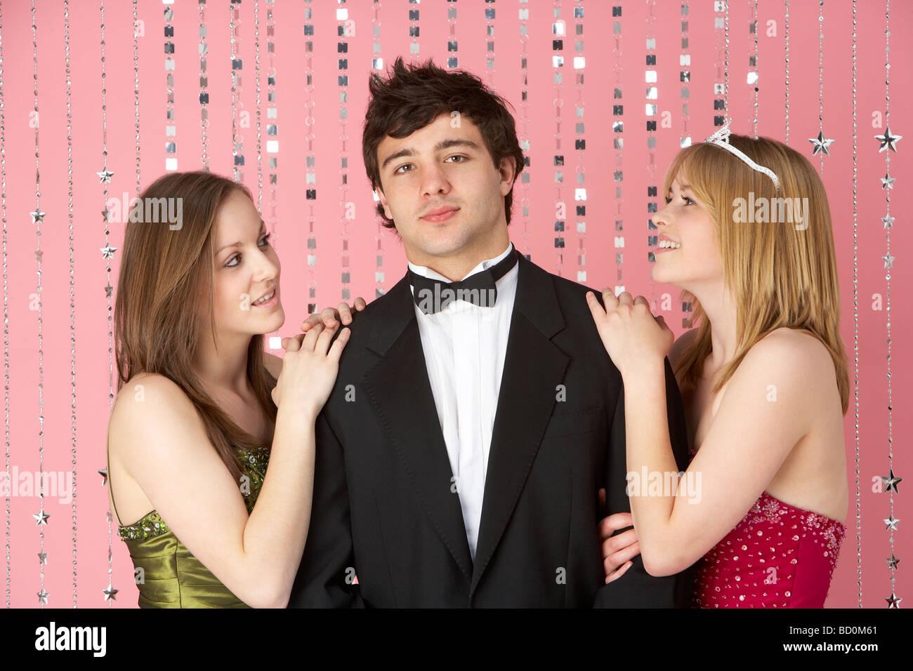 Two Teenage Girls Looking At Boy - Stock Image